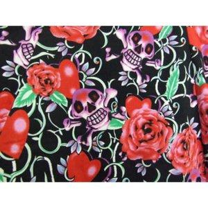 Kort klänning i rosa/rött med döskallar